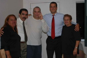 Client with his legal team, being reunited with his family after 9 months in jail